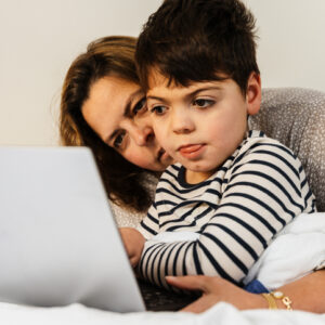 mother and child with disabilities on laptop